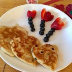 Valentine's Day Special: Chocolate chip heart pancakes with fruit flowers.